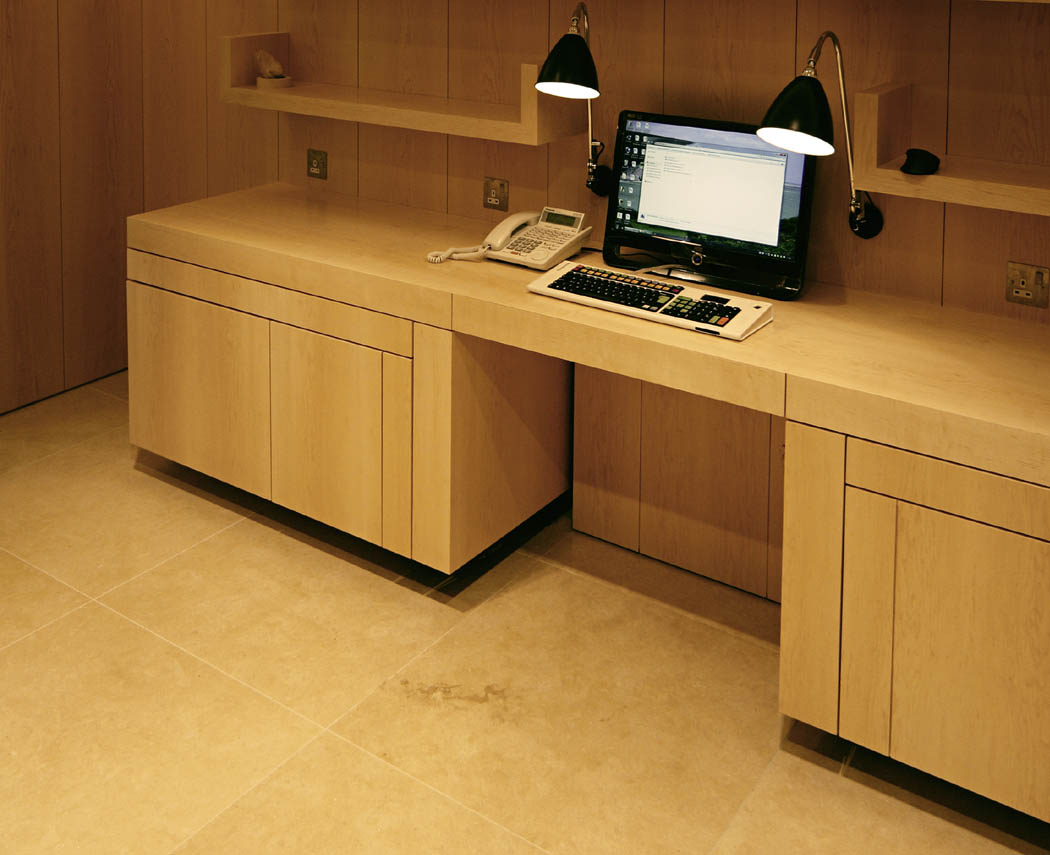 retracting automated desk closed